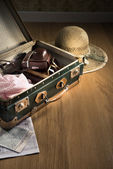 Fotografie Vintage luggage with sunglasses