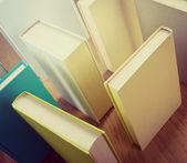 Books on floor composing a maze
