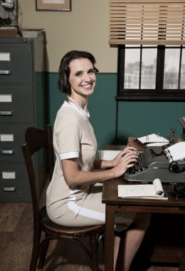 Young secretary typing at work