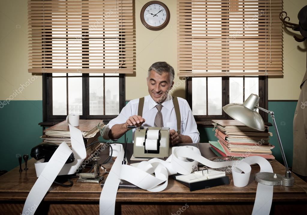 Accountant with adding machine Stock Photo by ©stokkete 56598485