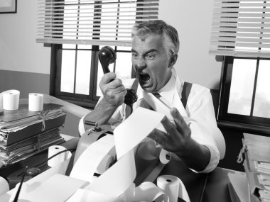 Angry vintage businessman shouting at phone