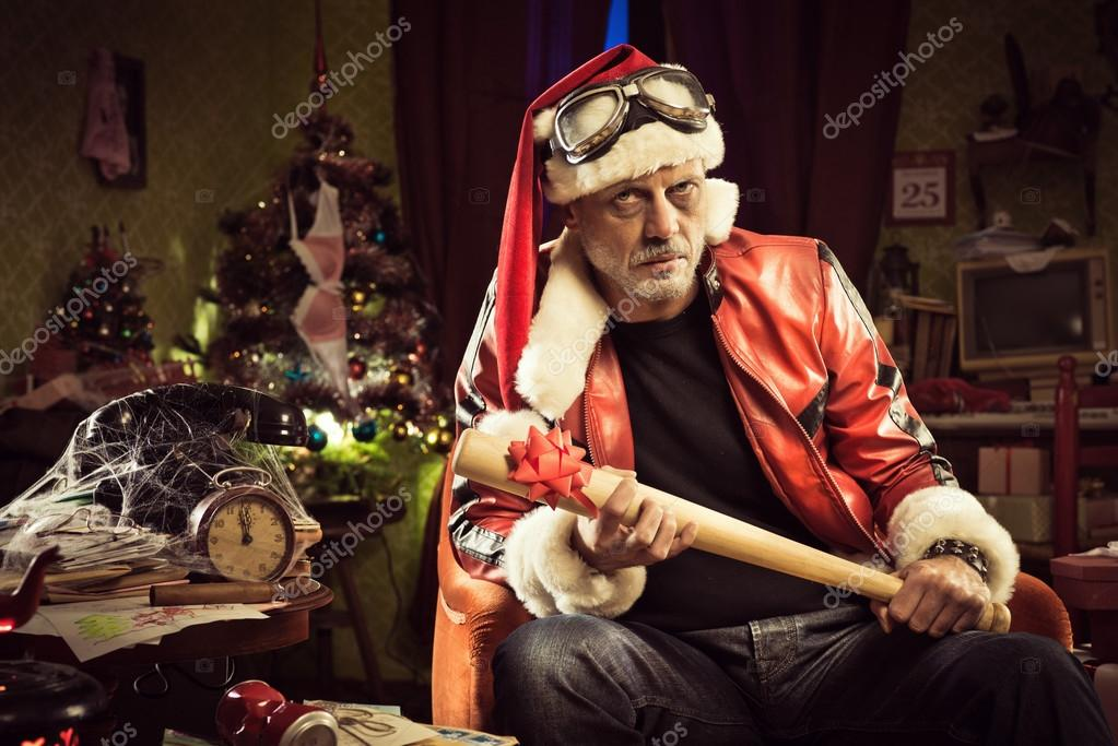 Bad Santa with bad Christmas gift — Stock Photo © stokkete #58984889