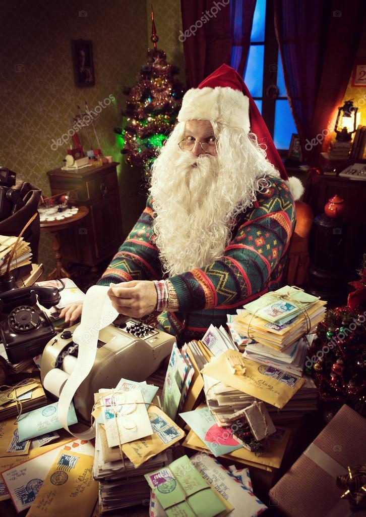 Santa Claus accountant checking bill
