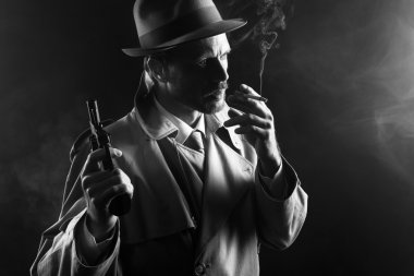 Gangster holding revolver