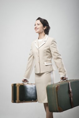 Woman holding suitcases