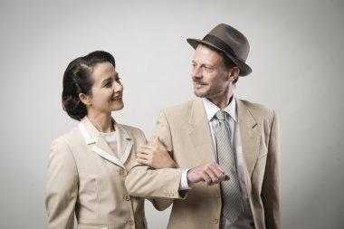 Elegant couple arm in arm