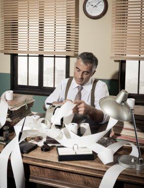 Accountant with adding machine