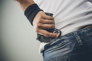 Man grabbing pistol