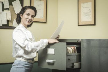 Secretary searching files