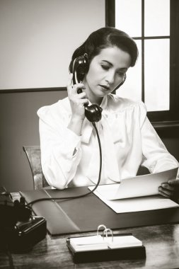 Secretary having phone call