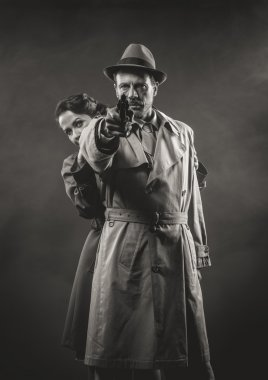 Man pointing gun and woman