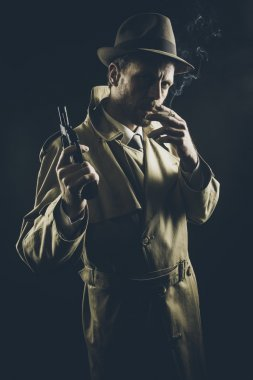 Gangster in trench coat smoking