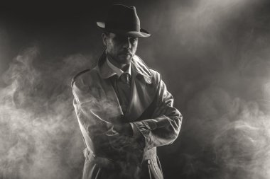 Mysterious man waiting in fog