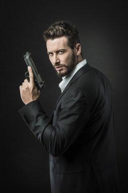 Confident undercover agent with gun