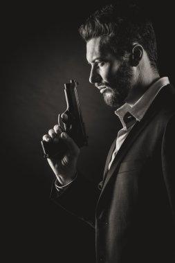Brave cool man holding gun