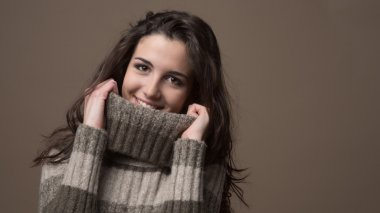 Woman with high collar sweater