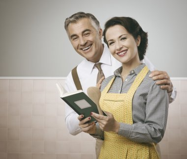 Wife and husband reading a cookbook