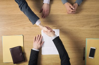 Business people handshaking after signing an agreement