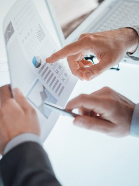 Businessmen examining a financial report