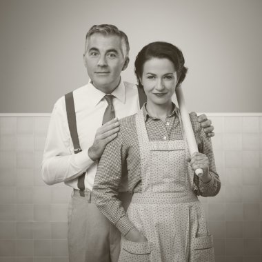 Happy vintage couple at home posing