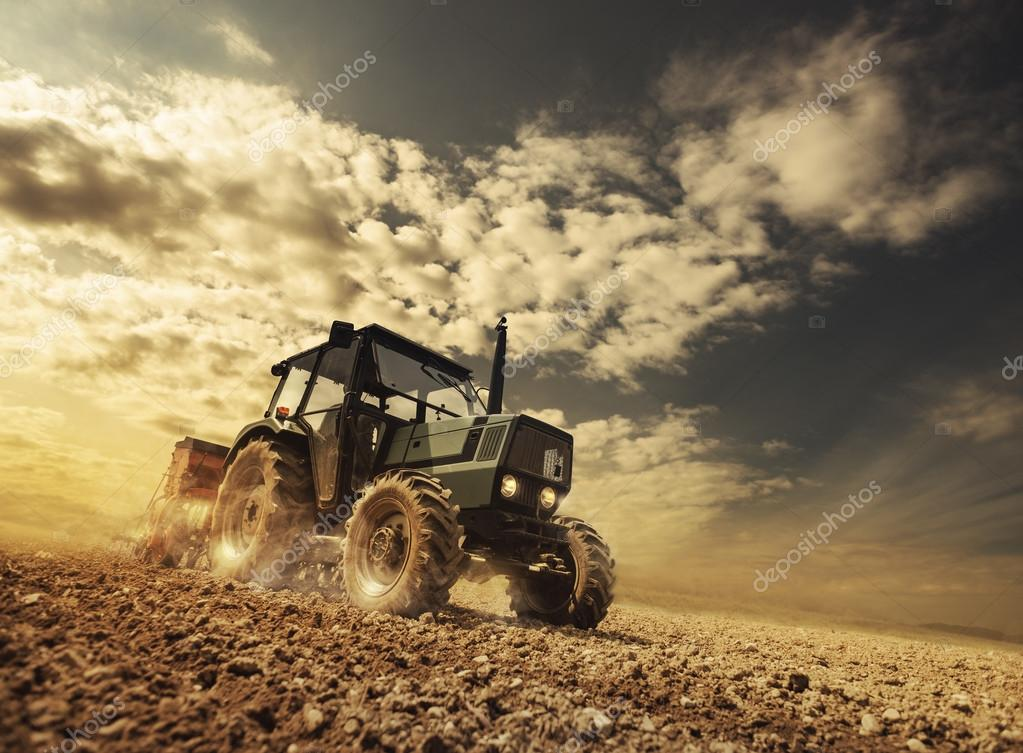 Farmer in the field driving a tractor