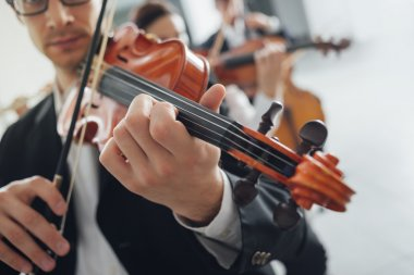 Violin players performing