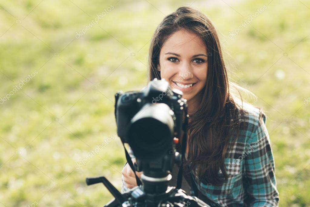 photographer using a professional digital camera