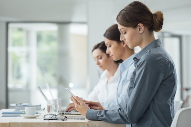 women working together at office desk