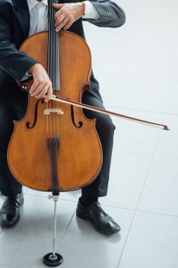 cellist playing his cello