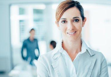 Confident woman entrepreneur posing