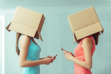 girls with boxes on their heads