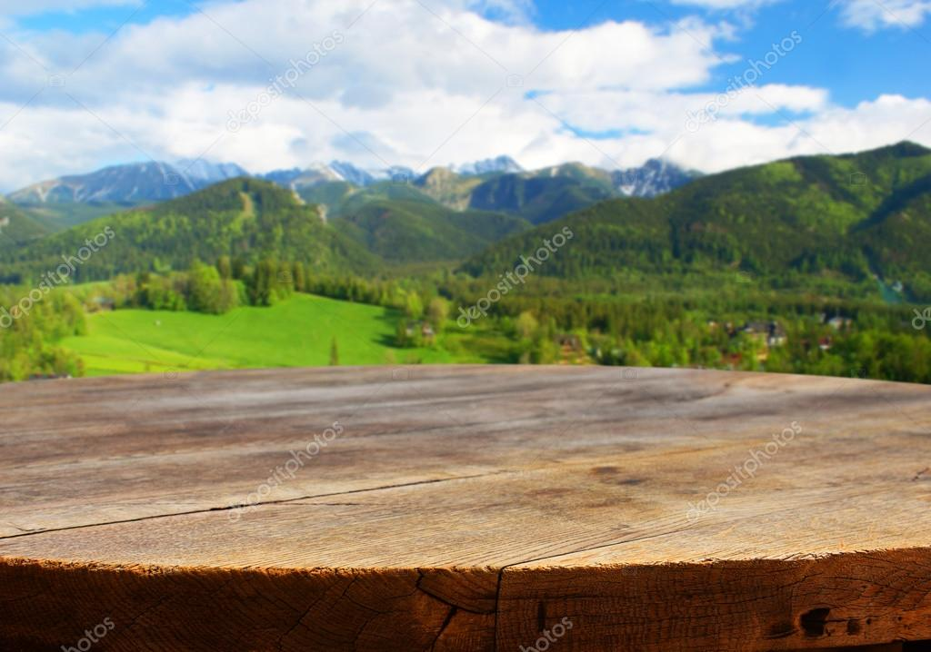Empty table with mountain background