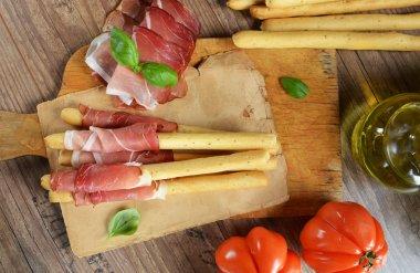 Grissini bread sticks with ham