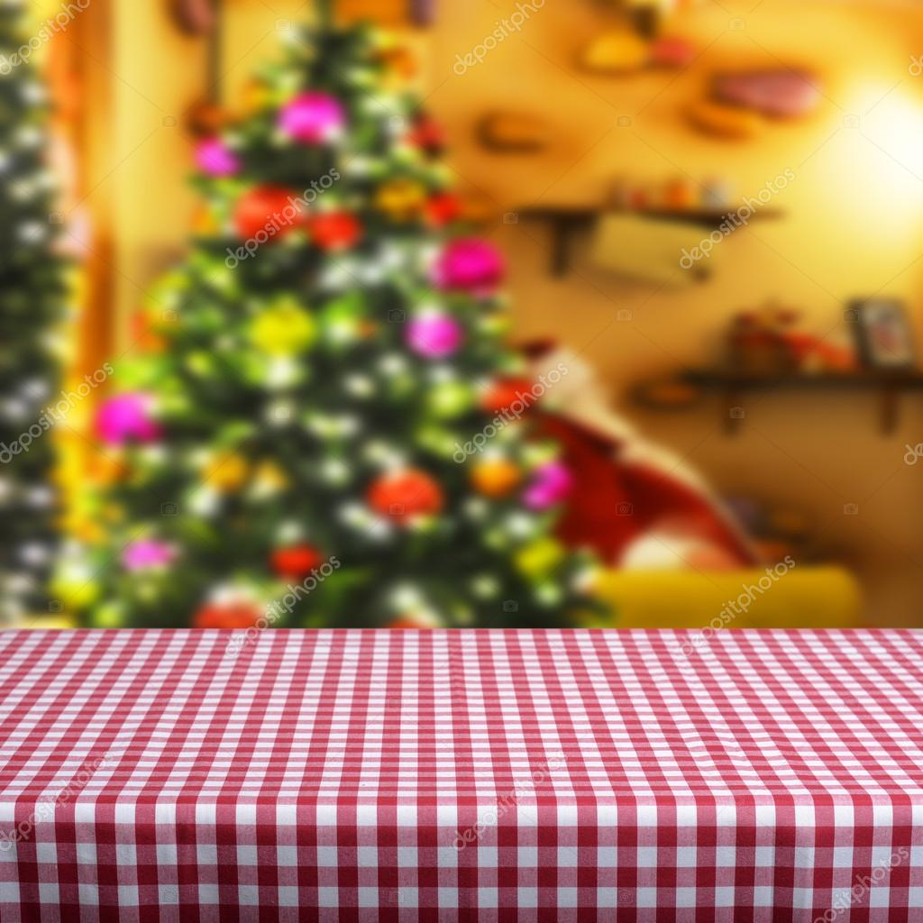 Empty table  with blurred Christmas tree
