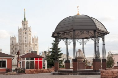 Gazebo and Stalinist skyscraper in Moscow