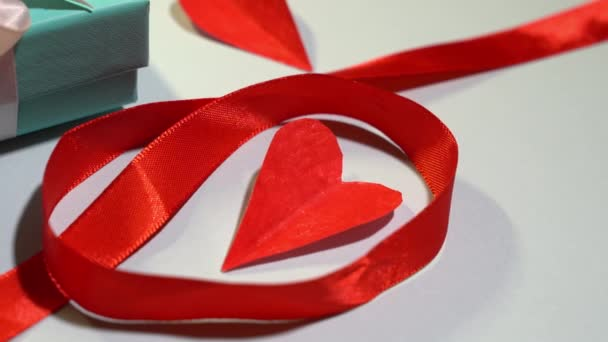 handmade heart made of paper on top of a face mask. Valentines day concept.