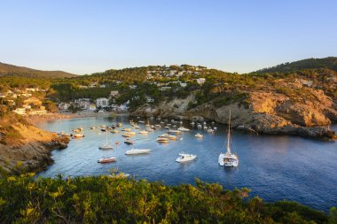 Sunset in the small bay of Cala Vedella, Ibiza island.