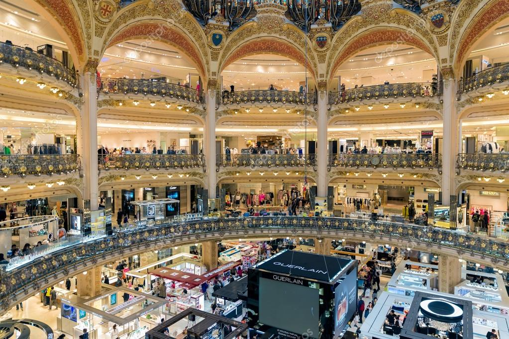 people shopping in luxury lafayette department store of paris