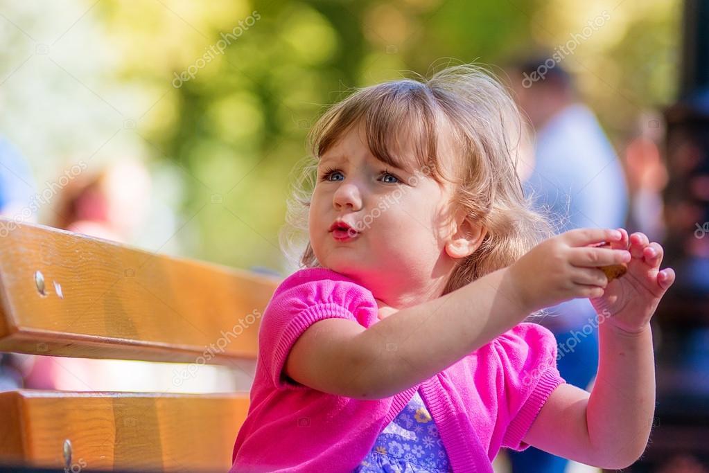 Beautiful sad little girl crying, on summer background.