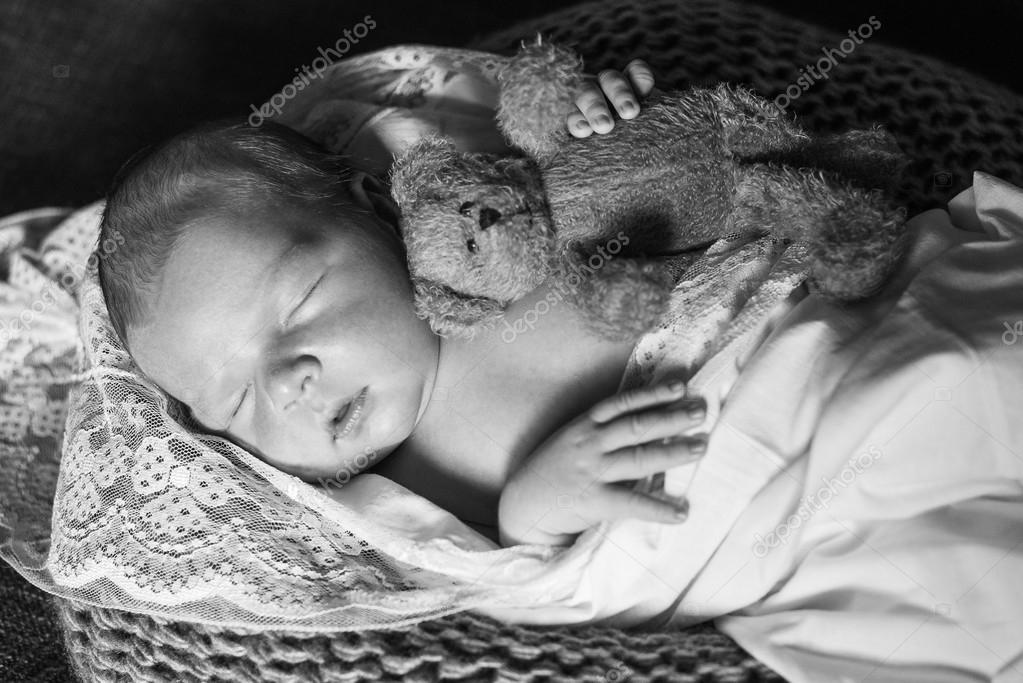 Sleeping Newborn Baby Wrapped In A Blanket Stock Photo C Lakschmi