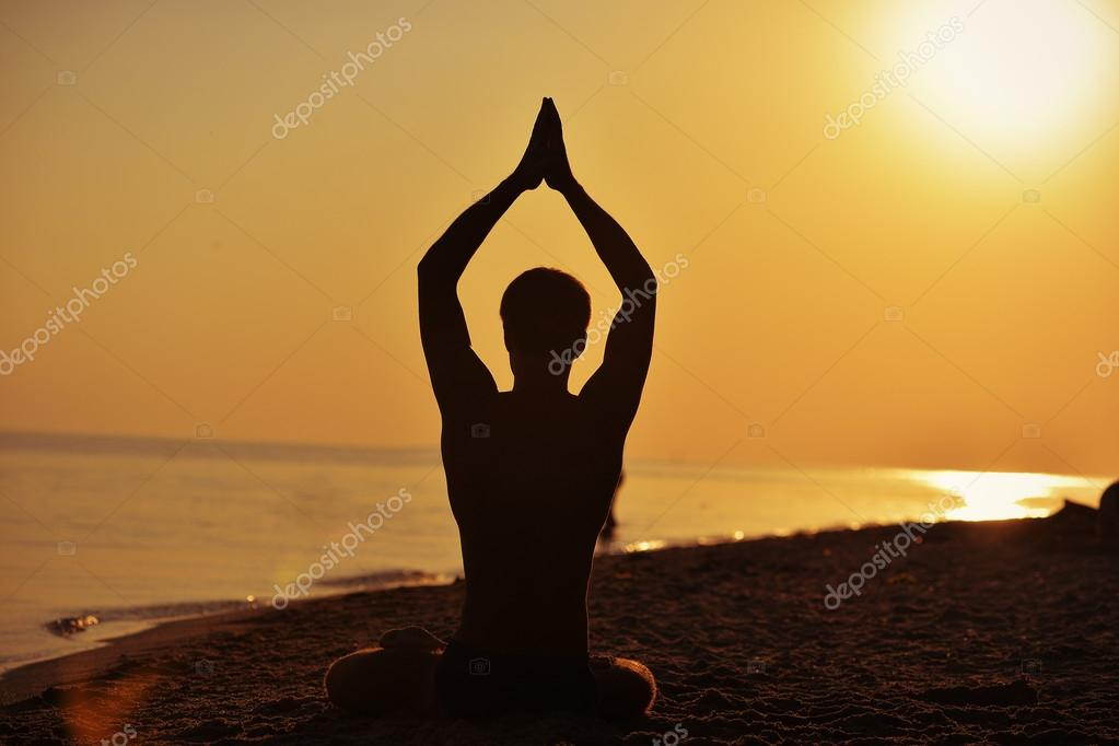 a man in the lotus position silhouette