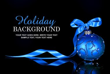 Christmas background with blue ornament and ribbon