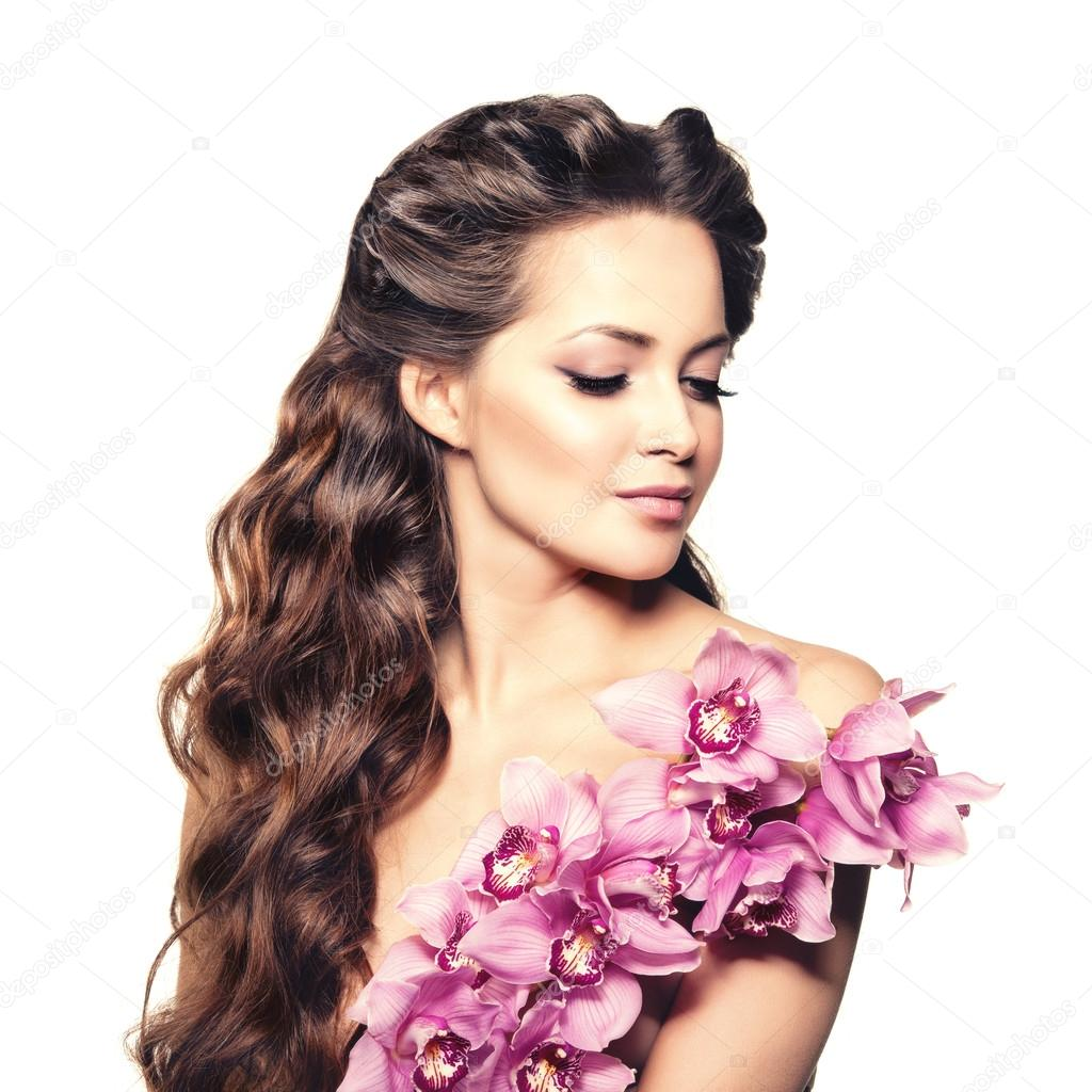 Beauty young woman, luxury long curly hair with orchid ...