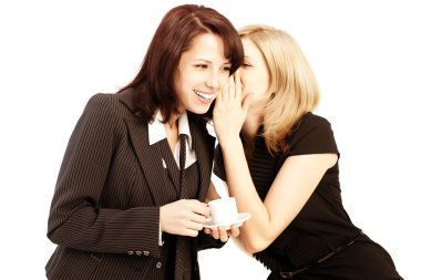 Business gossip. Women in the office. Two girls discuss the news