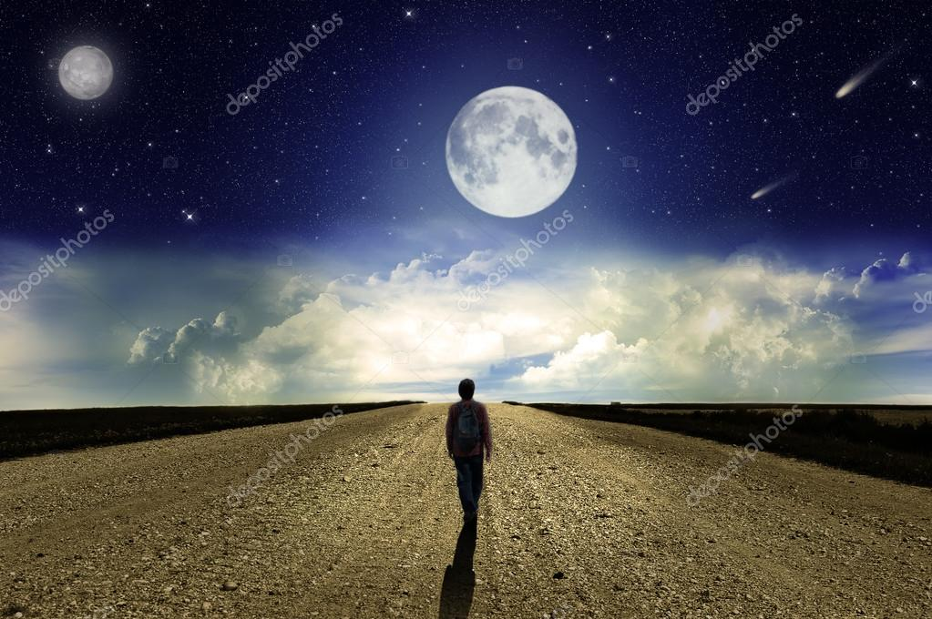 Man walking on the road at night
