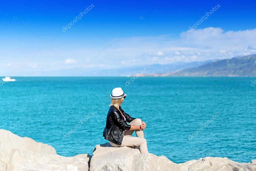 Attractive young woman over ocean