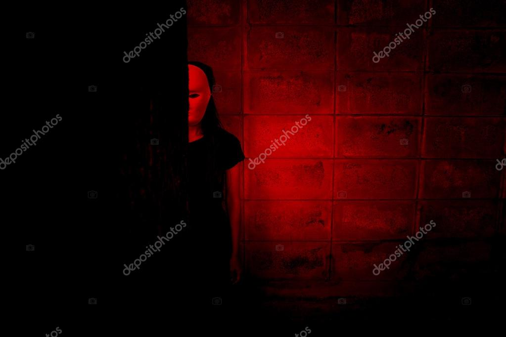 Mysterious Woman In Black Dress Wearing White Mask Hiding Behind TreeScary Background For Book