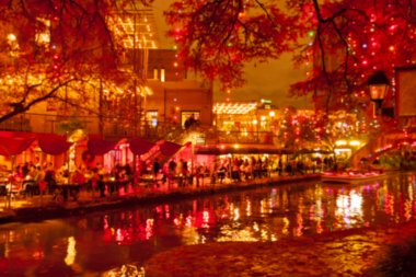 Blurred holiday background. River walk  in San Antonio city at n