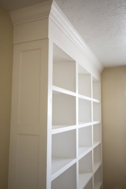 Elegant newly-built white book shelves indoor.