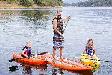 young family kayaking
